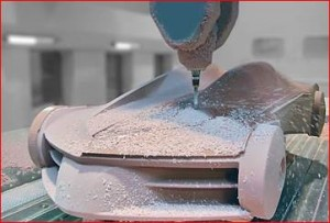 RAMPF Tooling Solutions products are used in a number of sectors, including the automobile industry. The photograph shows a 1:1 model of a sports car being milled out of Close Contour material from the RAKU-TOOL® brand.