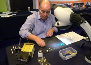 ■ The author taking part in the IPC Hand Soldering Competition.