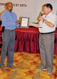 ■ Keith Bryant presents David Vetharudge, Chapter Advisor of the Penang Chapter with the SMTA award, Excellence in International Leadership.